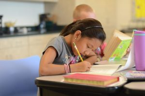 An image of a student which represents Crete private elementary school, call us today!